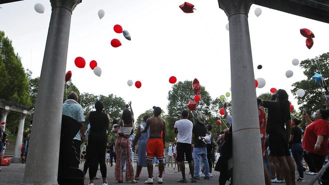 Family and friends release balloons in memory of Henry Green, who died in a confrontation with Columbus police four years ago on June 6. The People's Love event organized by the People's Justice Project was hosted at Franklin Park on June 6, 2020.