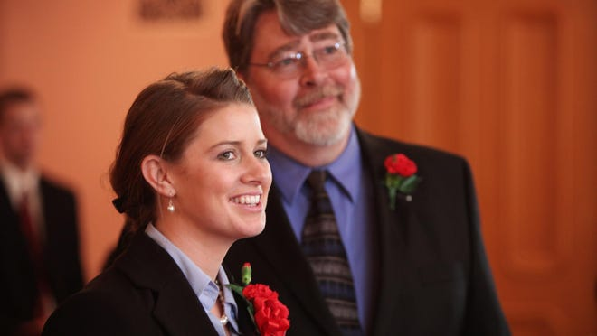 Christina Hagan moments before she was sworn into the Ohio House in March 2011 by her father John P. Hagan a former representative. John Hagan is now a member of the state Board of Education.