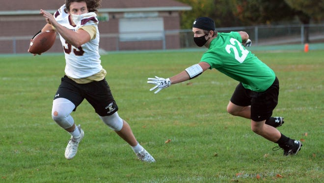 Killingly's Jack Sharpe spins away from Griswold's Ryan Pellilo for a gain during their 7-on-7 competiton Friday in Griswold.