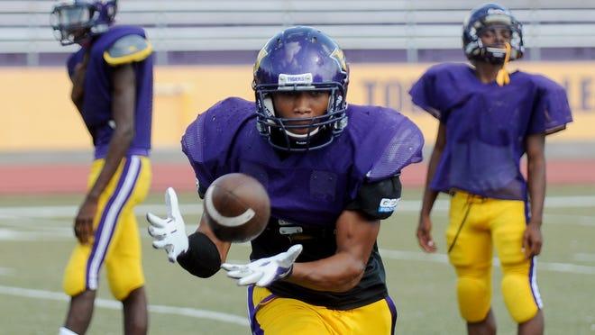 Hattiesburg High School football players run offensive drills Tuesday at Hattiesburg High in preparation for their Saturday game against Petal High School.