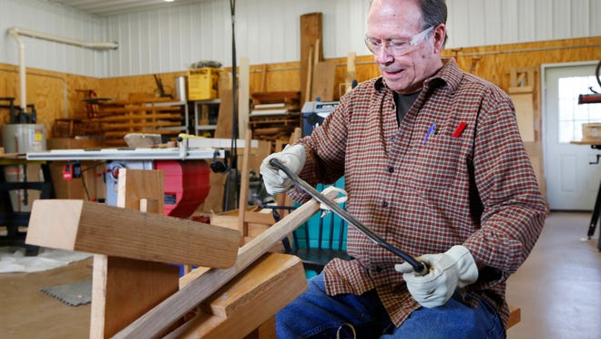 While seated at a shaving horse, Steve Clark uses a drawknife to shape a piece of red oat into a spindle for a chair Wednesday, April 22, 2015, in his workshop south of Lafayette. A racial discrimination incident that occurred 15 years ago has racked Clark's conscience with guilt. Retired, Clark has time on his hands, and he thinks about his life's accomplishments and failures while woodworking.