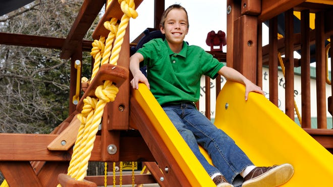 Dominic Ballou, 10, St. Joseph, is trying to raise enough money to purchase a Rainbow Play System to replace the aging metal playground equipment at his low-income housing complex in St. Joseph. Ballou does some window shopping for the right system at Rainbow Play Systems in St. Cloud on Wednesday.