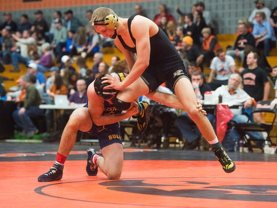 Delone Catholic's Brady Repasky tries to avoid Littlestown's Connor Geiman during the 182-pound seminfinal bout Saturday during the Section I AA wrestling at Susquenita High School.