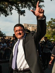 LSU interim head coach Ed Orgeron waves to the crowd before the LSU-Missouri game on Saturday, October 1, 2016.