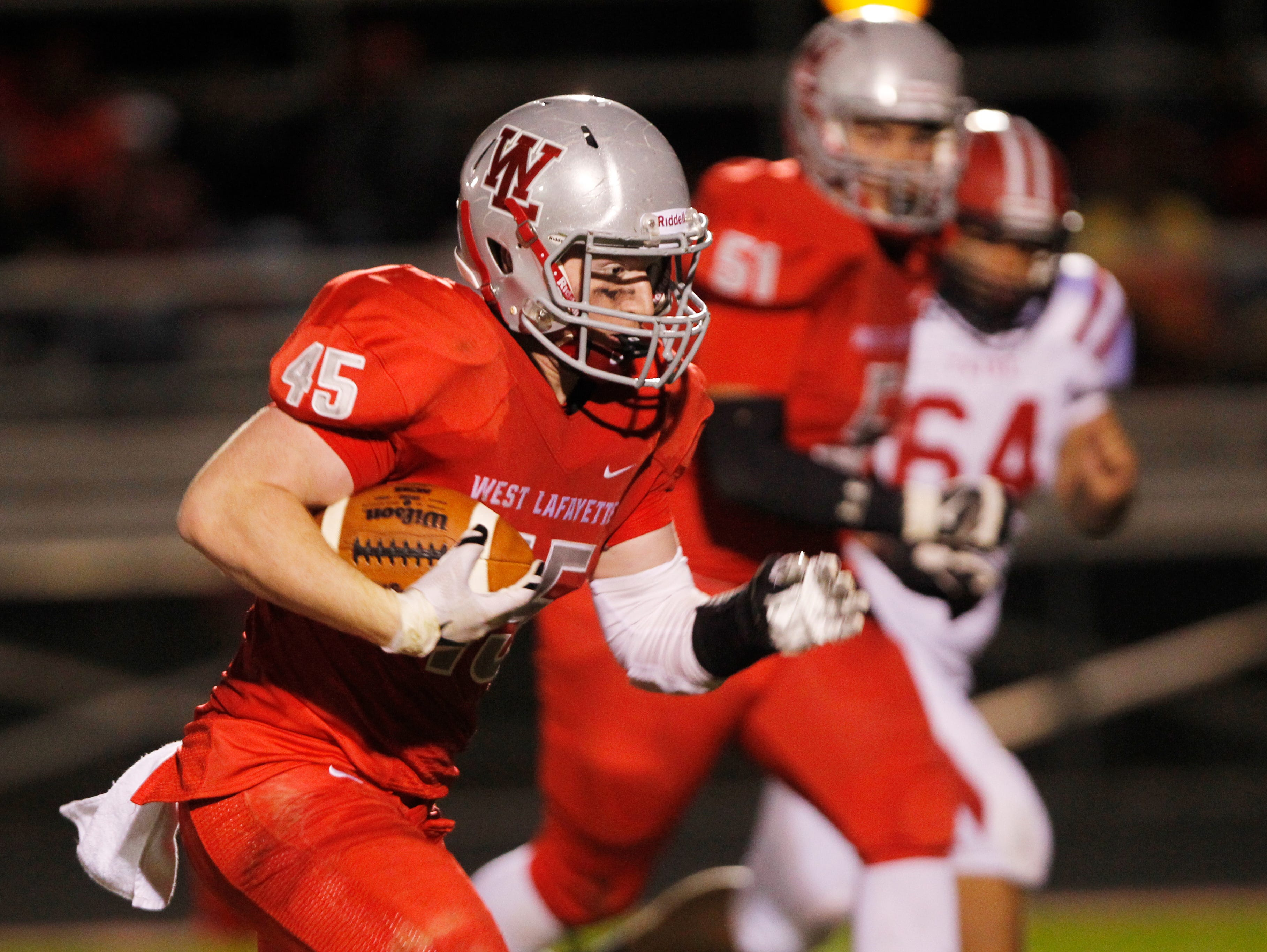 West Lafayette's Nate Merriott returns an interception for a touchdown at 10:59 in the third quarter against Twin Lakes Friday, October 9, 2015, in West Lafayette. Merriott's score put West Lafayette up 21-6. West Lafayette would go on to defeat Twin Lakes 56-6.