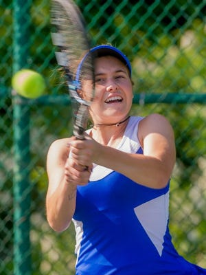 DANIEL R. PATMORE / SPECIAL TO THE COURIER & PRESS Memorial's Makenzie Myers returns the ball to Mater Dei's Lauren Marx in the championship singles match of the 2016 SIAC tournament Wesselman Park Tennis Courts.