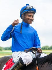 Jockey Marlon St. Julien gives a thumbs-up and he rides Innovative Idea (1) into the winner's circle after win The 35th running of The Groupie Doll a one mile race for fillies and mares three years old and up at Ellis Park in Henderson, Ky. Saturday afternoon, Aug. 6, 2016.
