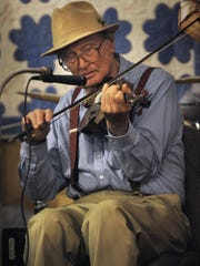 Ronald W. Erdrich/Reporter-News Bill Burns plays fiddle with the house band during the 46th annual Sagerton Hee Haw Friday April 1, 2016. The homespun variety show features corny jokes and players who either live in or have some connection to Sagerton, a small community in Haskell County.