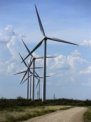 Wind turbines spin along Chimney Creek Ranch Road off State Highway 351 in Shackelford County.