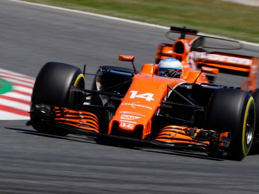 Mclaren driver Fernando Alonso of Spain steers his car during the qualifying session for the Spanish Formula One Grand Prix at the Barcelona Catalunya racetrack in Montmelo, Spain, Saturday, May 13, 2017. The Spanish Formula One Grand Prix will take place on Sunday. (AP Photo/Manu Fernandez)