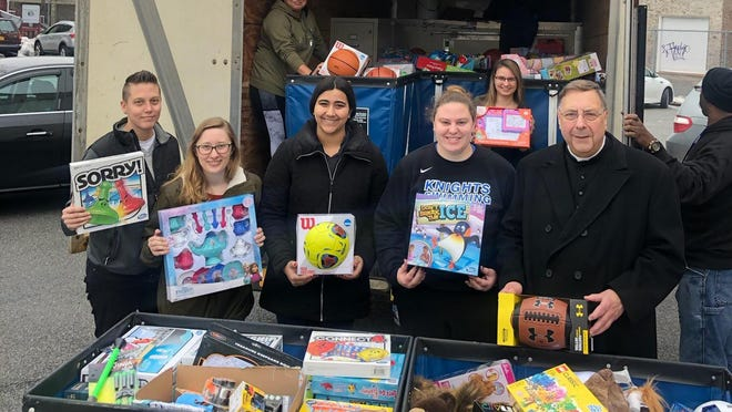 Students from Mount Saint Mary College's campus ministry program delivered nearly 2,000 toys to Catholic Charities of Orange, Sullivan, and Ulster. Pictured with student volunteers are Melody Sarno, second from left, Assistant Director of Campus Ministry, and Fr. Fluet, right, Chaplain and Director of Campus Ministry.