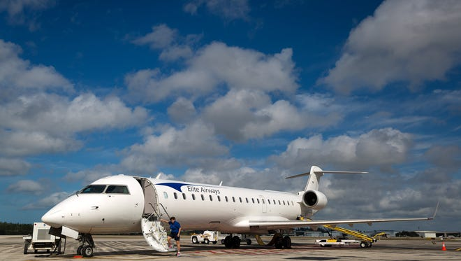 An Elite Airways Bombardier CRJ-700 jet sits on the tarmac of the Naples airport after a press conference announcing details about new commercial flights on Wednesday, Feb. 3, 2016.