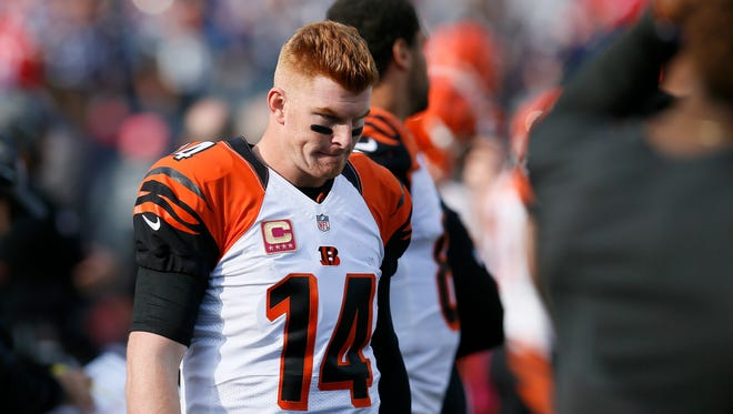 Cincinnati Bengals quarterback Andy Dalton (14) paces the sideline between drives in the fourth quarter of the NFL Week 6 game between the New England Patriots and the Cincinnati Bengals at Gillette Stadium in Foxboro, Mass., on Sunday, Oct. 16, 2016. The Bengals fell to 2-4 with a 35-17 loss in Tom Brady's first home game since his four-game suspension.