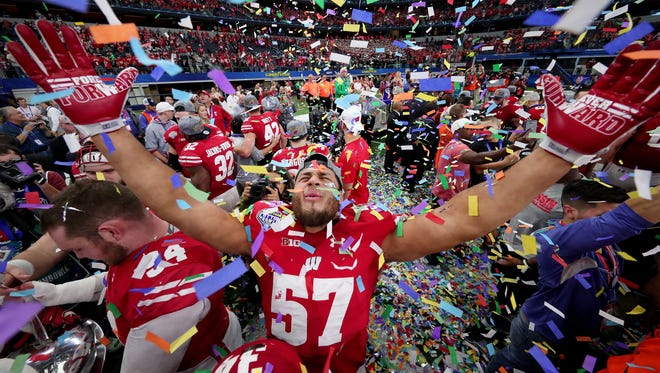 Wisconsin celebrates winning the Cotton Bowl in 2016. A year earlier, Cotton Bowl president Rick Baker celebrated making $1.2 million running the game.