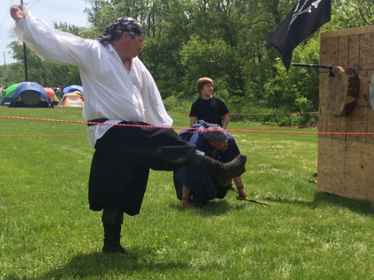 Jeff Seward lets go of a throwing ax with some style at the Iowa Renaissance Festival in Middle Amana on Saturday.