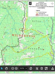 The yellow indicates trail closures in relation to fires, shown in red.