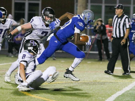 Sayreville's Elijah Clark runs the ball as Old Bridge