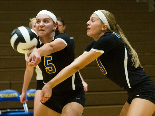 DANIEL R. PATMORE / SPECIAL TO THE COURIER & PRESSCastle's Jessica Nunge (5) returns the ball before team mates Ashley Odom (9) can in the first match of the IHSAA Volleyball Regional against Floyd Central at Castle High School in Newburgh, Ind. Tuesday evening, Oct. 25, 2016. Floyd Central Won 3 - 1