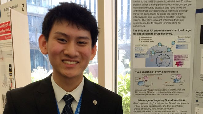 Eric Chen, and Intel winner this year, shows off a model of endonuclease, the flu-virus enzyme against which he is targeting a new type of disease-fighting drug.