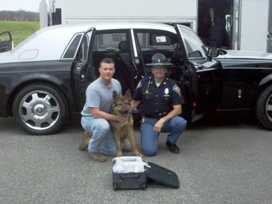 Indiana State Police K9 'Hondo' sniffed out 11 kilos of cocaine inside the Rolls-Royce Phantom.