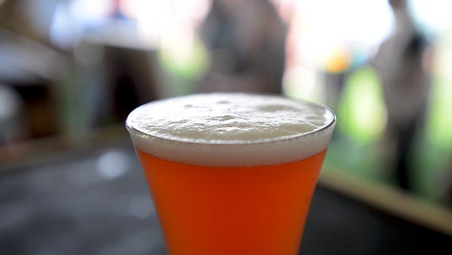The Bomb Pop, styled after the sour-ish Berliner Weisse beers of Germany, from Good Measure Brewery made with 120 tri-flavored popsicles, at the Vermont Beer Fest in Burlington on Friday afternoon, July 21, 2017.
