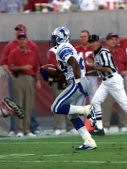 Lions cornerback Terry Fair runs back this 35-yard fumble against the Cardinals on Nov. 14, 1999 at Sun Devil Stadium in Tempe, Arizona.