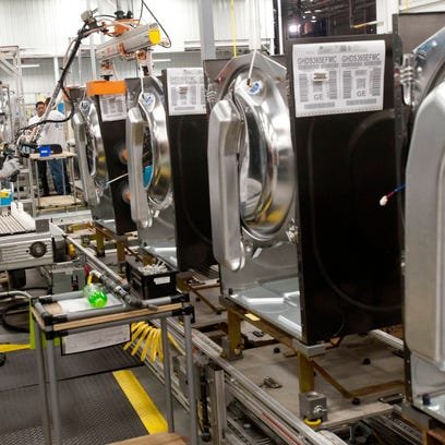 General Electric employees assemble the company's new dryers at Appliance Park in 2013.