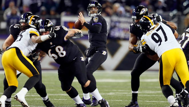 Baltimore Ravens quarterback Joe Flacco (5) looks downfield against the Pittsburgh Steelers on Thanksgiving at M&T Bank Stadium in Baltimore.