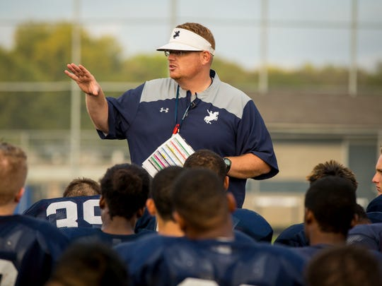 Roosevelt High School head coach Erik Link talks to