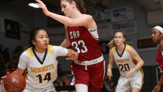 Natayah Saetern, left, looks to take the ball past Sacred Heart Prep's Tatum Angotti on Saturday night in the second round of the Division III state championships. Sacred Heart Prep came out on top 48-39.