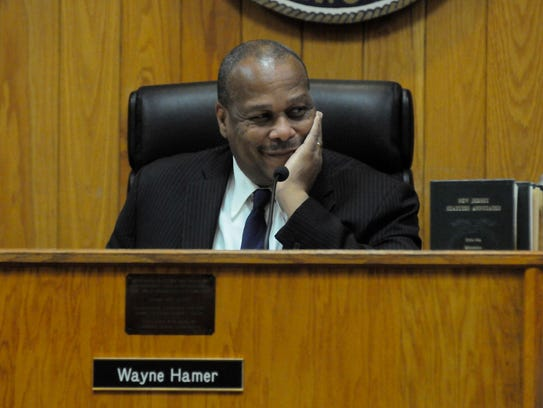 Wayne Hamer sitting in the council president's seat