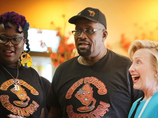 Hillary Clinton, Democratic presidential candidate, stops by Sweet Potato Sensations at 17337 Lahser in Detroit Tuesday, July  21. With Clinton are Jeffery Thomas, center, and his daughter C. Espy Thomas, two of the eatery's owners.