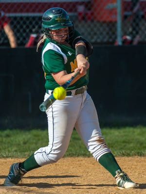 Mardela third baseman Kasey Goshorn (15) makes contact with one out remaining but flies out to left against Colonel Richardson in the MPSSAA 1A East Softball Region Finals on Friday afternoon in Federalsburg.