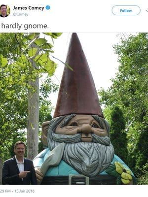 James Comey poses with a gnome in Ames' Reiman Gardens in a tweet he posted Friday, June 15, 2018.