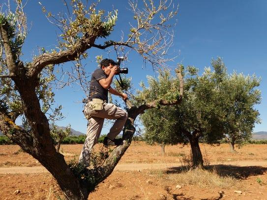 Photographer Joel Salcido Ruiz at work in Spain.