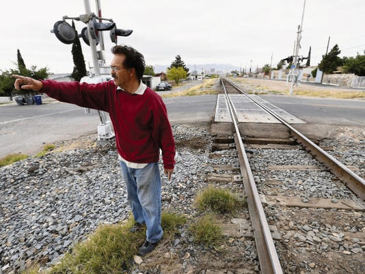 Juan Rodriguez, who lives on Maple Street right beside a set of train tracks, has his concerns about closing the railroad crossing to vehicles and pedestrians.