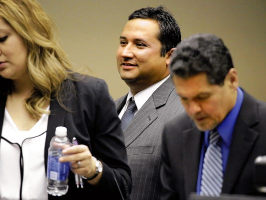 RUBEN R RAMIREZ—EL PASO TIMES Former Socorro city Rep Jesse Gandara (center) prepares to leave the courtroom with his attorneys, for the lunch break just after closing arguments were held today in his bribery trial.