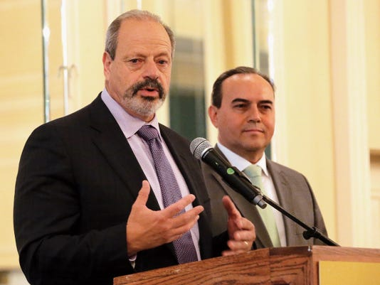 El Paso Mayor Oscar Leeser stands along side the Chihuahua Mayor Javier Alfonso Garfio after Garfio spoke during the El Paso Central Business Association  luncheon at the Camino Real Hotel.