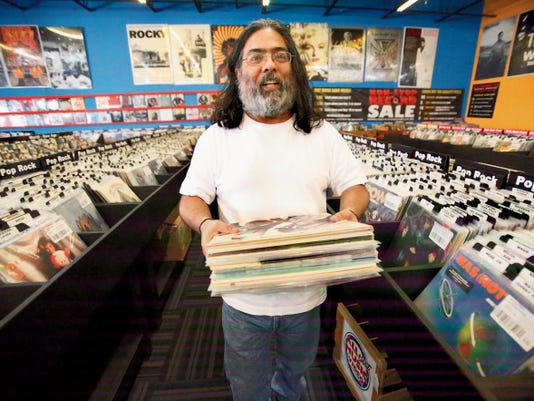 Frank Salazar checks vintage vinyl stock Wednesday at All That Music & Video at 6800 Gateway East.