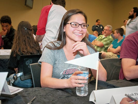 17-year-old Oñate High School senior Celeste Nuñez waits to show a Certificate of Intent, signifying her acceptance of a scholarship to attend the University of New Mexico, during a signing-day ceremony Wednesday at Arrowhead Park Medical Academy.