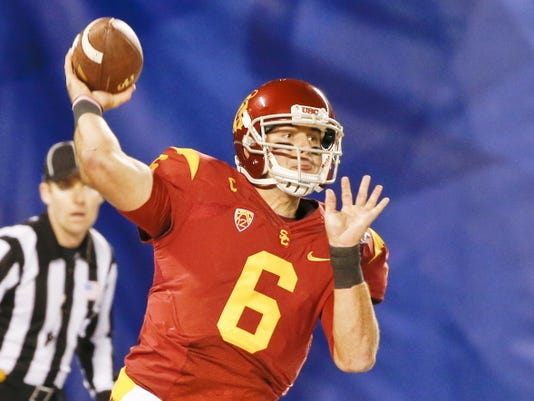 FILE - In this Dec. 27, 2014, file photo, Southern California quarterback Cody Kessler throws a pass against Nebraska during the first half of the Holiday Bowl NCAA college football game in San Diego. Kessler thinks his third season as USC's starting quarterback will be the season when the Trojans finally have the depth and poise to live up to their lofty expectations. (AP Photo/Lenny Ignelzi, File)