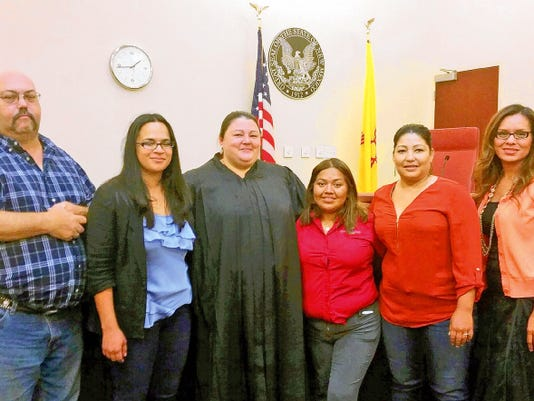 New Mexico Sixth Judicial District Court Judge Jennifer DeLaney, center in robe, swore in Court Appointed Special Advocates, from left, Richard McNutt, Viviana Silva, Amelia Mendoza and Loreno Esparza. At far right is CASA Director Mayra Solis.