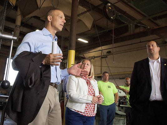 U.S. Rep. Scott Perry, left and state Reps. Kate Klunk and Seth Grove tour KLK Welding Tuesday, Sept. 1, 2015. The legislators also visited the welding lab at South Western High School as part of program to train high school students for the workforce. Bill Kalina - bkalina@yorkdispatch.com