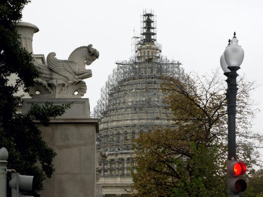 The Capitol Dome, covered with scaffolding is seen on Capitol Hill in Washington, Wednesday, Sept. 30, 2015. On Wednesday, the Senate easily approved a stopgap spending bill to avert government shutdown; House to follow. (AP Photo/Carolyn Kaster)