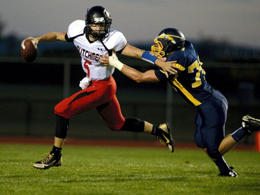 Annville-Cleona quarterback Adam Fox is flushed out of the pocket by Elco 's Nate Hostetter during the teams' meeting last year at Elco High School in September. Annville-Cleona won, 42-21.