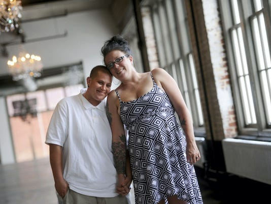 After four years together, Amanda Lynn Bowden, left, and Melissa Anne Palmer, are getting married during Equality Fest, at the Bond building Sunday, Aug. 2.