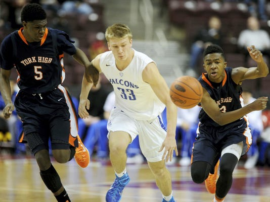William Penn's Montrel Morgan, right, knocks the ball away from Cedar Crest's Evan Horn during William Penn's, 56-53, victory in the District 3 Class AAAA championship game at Giant Center in Hershey.
