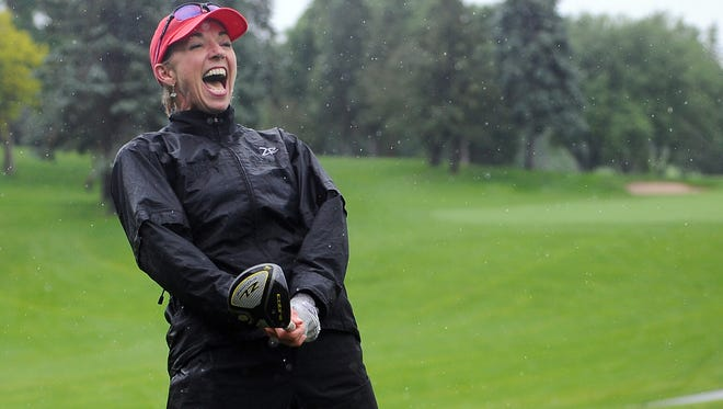 Professional golfer Kris Tschetter reacts after trying to golf with a short club during the YMCA Youth Golf Clinic at Minnehaha Country Club in 2014.