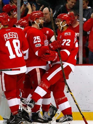 Andreas Athanasiou, right, celebrates his overtime goal with Mike Green to defeat the Minnesota Wild, 3-2, on Sunday, March 26, 2017 at Joe Louis Arena.