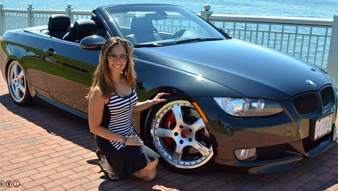 Mindi Villaroman of Pensacola shows off her custom BMW, which is expected to be part of PensaCruise 2015.